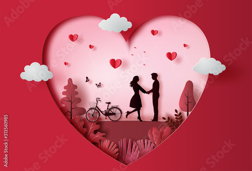 Obraz Young couple holding hands in park with many heart floating, paper art style. - fototapety do salonu