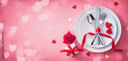Red table setting cutlery for valentines days dinner - 313564745