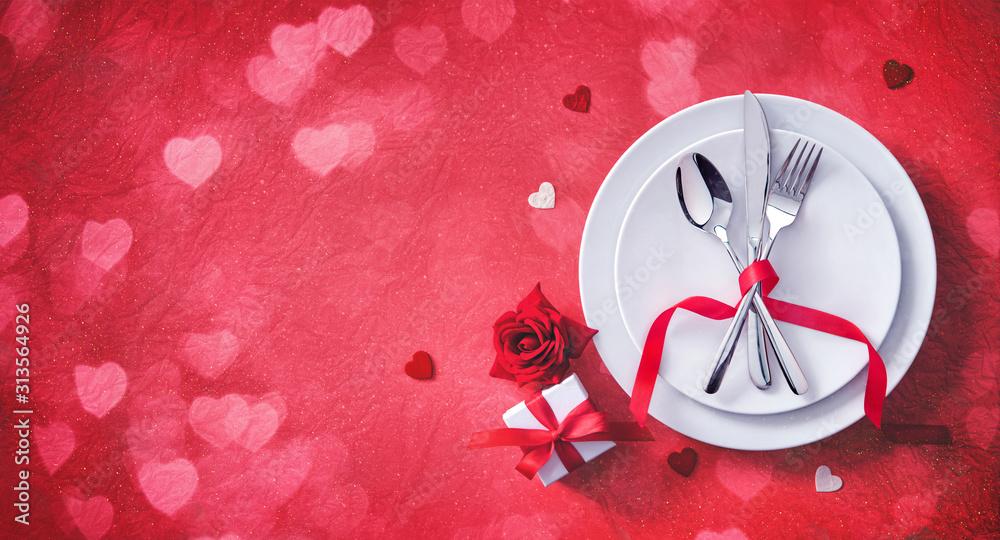 Fototapeta Red table setting cutlery for valentines days dinner