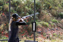 Shooter From A Gun Practicing Shooting On Plates In Nature