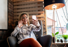 Young Woman Using Smartphone F...
