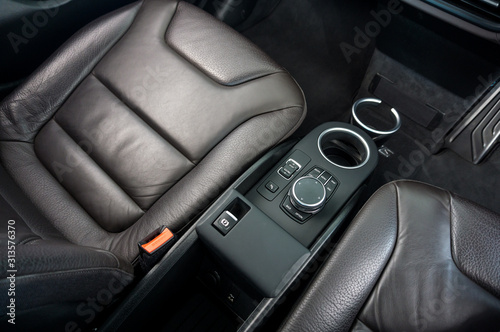 Obraz na plátně Top view of Car Interior with Driver, Passenger seat and cup holder on background