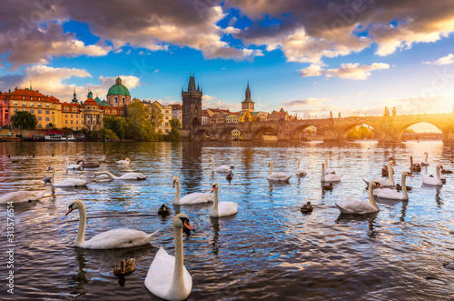 Leinwand Poster Autumn view to Charles bridge on Vltava river in Prague, Czech Republic
