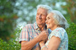 canvas print picture Close up portrait of beautiful senior couple hugging