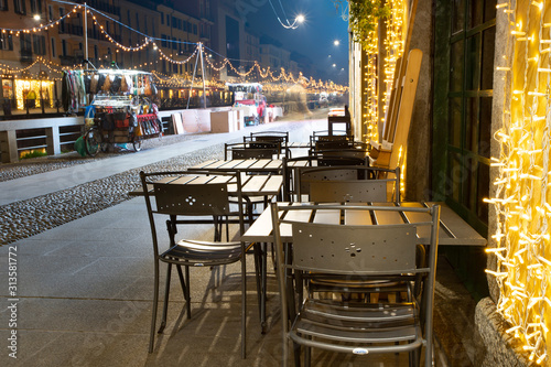 Christmas decorated milanese streets by late night. Wallpaper Mural