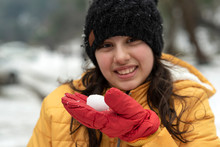 Young Girl Holding Little Snow...