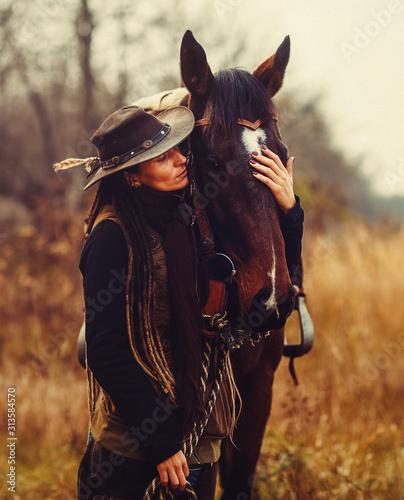 Fototapeta Portrait woman and horse outdoors. Woman hugging a horse. obraz