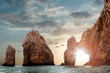 canvas print picture - Rocky formations on a sunset background. Famous arches of Los Cabos. Mexico. Baja California Sur.