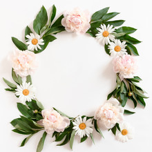 Wreath Made Of Pink Peonies, White Chamomile And Green Leaves