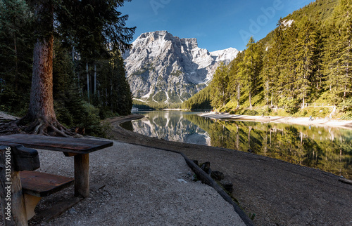Wall mural - Incredible Nature landscape. Famous alpine place of the world Amazing Braies Lake with Seekofel mount on background. Awesome nature Scenery. Popular plase for photographers. Beautiful in the World