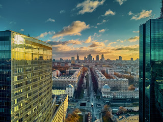 Fototapeta Warszawa Beautiful panoramic aerial drone view to the Сenter of modern Warsaw city with silhouettes of skyscrapers in in the rays of the setting winter January sun - amazing sunset, Poland