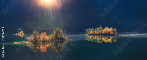 Obraz Charming autumn  landscape of islands with pine-trees in the middle of Eibsee lake. - fototapety do salonu