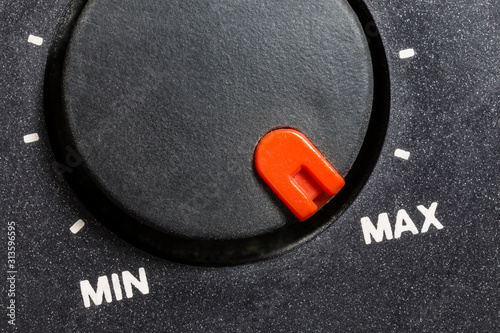 Photo Close up macro view of vintage tape machine volume dial set to MAX