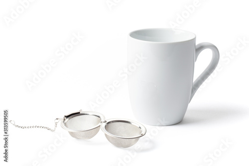 Obraz na plátne  Open Tea Strainer Infuser and a Cup