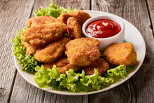 Close Up Plate With Fried Chicken Nuggets With Lettuce And Ketchup
