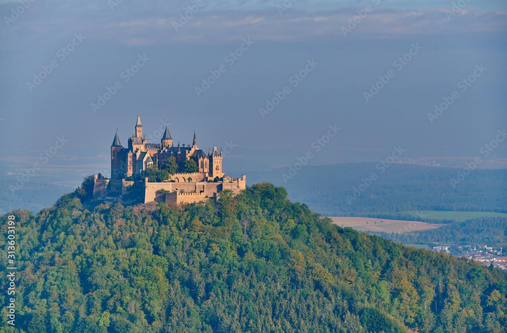Fototapeta Hilltop Hohenzollern Castle on mountain top in Germany