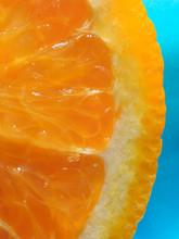 Orange Slice On A Blue Background Close Up