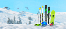 Ski, Poles; Snowboard, Gloves, Helmet And Goggles Pinned To The Snow At The Ski Resort. Free Space Beside For Text. Ski Lift And Slope In The Background.
