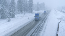 Trucks Haul Containers Across The State Of Washington And Through A Snowstorm.