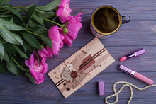Vintage Envelope, Cup Of Cuffee, Pink Flowers And Female Accessories. Top View, Flat Lay.