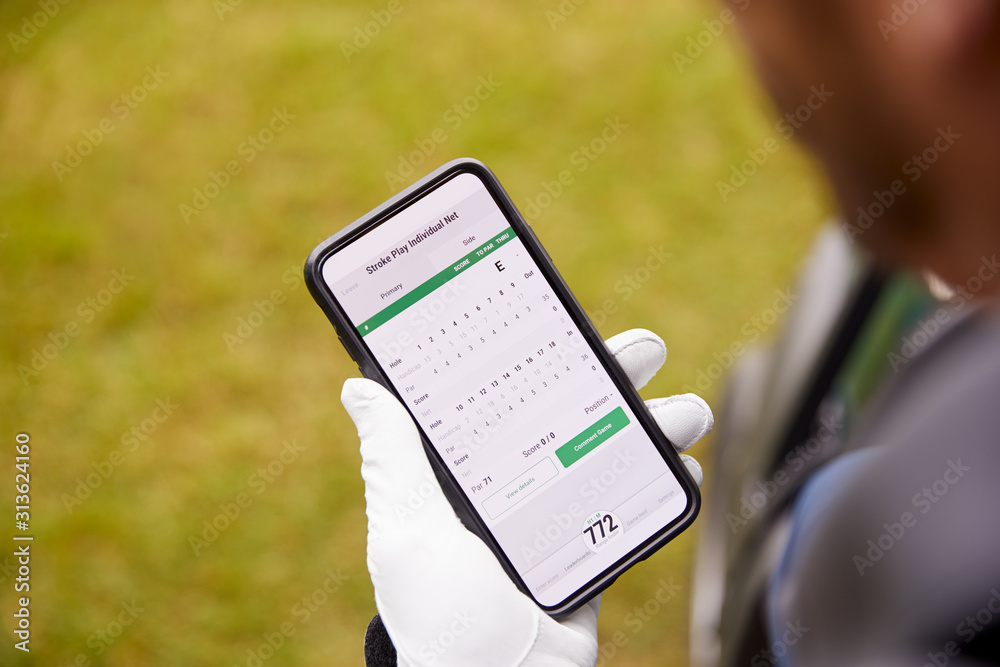 Fototapeta Close Up Of Male Golfer In Buggy Checking Score On Mobile Phone App