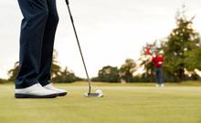 Close Up Of Female Golfer Putt...