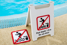 Sign That Says No Jumping Diving