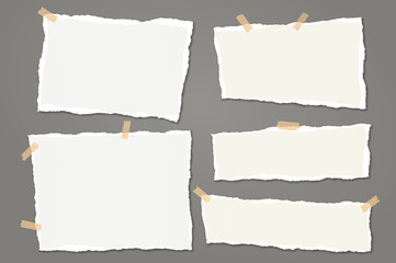 Set of torn white note, notebook paper strips and pieces with soft shadow stuck with sticky tape on dark grey background. Vector illustration