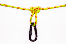 New Black Oval Touristic And Alpinistic Carabine Hangs From Butterfly Loop Knot. Stretched Colored, Green Rope For Personal Belaying. Self-insurance Mustache. Isolated On White Background.
