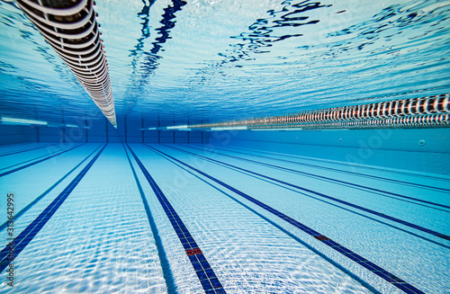 Photo Olympic Swimming pool under water background.