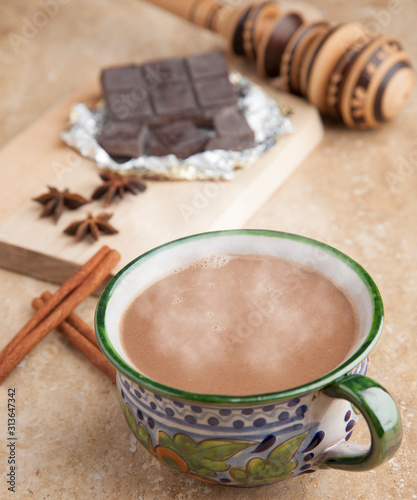 Fototapeta cup of hot chocolate with cinnamon sticks obraz