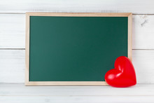 Greenboard With Red Heart On White Wood Background , Empty Board ,  Love And  Education Concept With Copy Space.