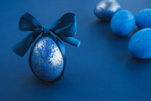 Blue Easter Egg With Ribbon On...