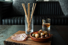 Antipasto Board With Meat, Cheese, Olives And Breadsticks