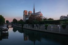 Notre Dame On Œle De La CitÈ Seen From Across The River Along The  Seine At Sunrise