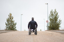 Rear Vision Of A Disabled Man ...