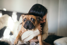 A Tattooed Woman Hugging Her C...
