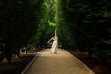 Rear View Of A Woman Dancing B...