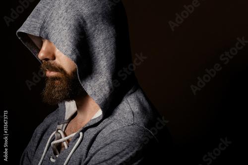 Fotografiet brutal man with a beard in the studio