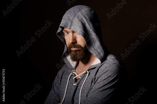 brutal man with a beard in the studio Fototapet