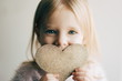 canvas print picture - Valentines day. Little girl with a heart. Portrait of a little girl holding valentine's card.