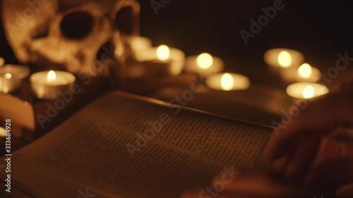 Fototapeta Altar with magical grimoire closeup photo