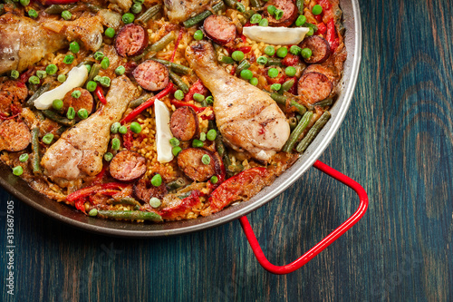 Traditional paella with chicken legs, sausage chorizo and vegeta Canvas Print