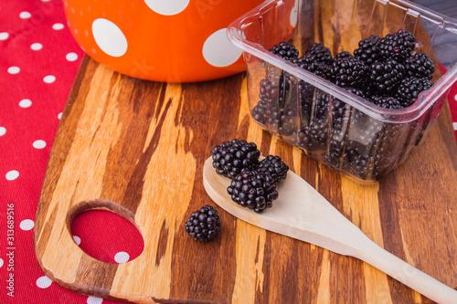 Fényképezés Fresh raw blackberries prepared for cooking jam