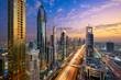 Leinwandbild Motiv Aerial night view of the skyscrapers along the Sheikh Zayed Road in Dubai, UAE