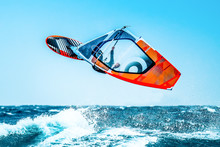 Summer Sports: Windsurfer Jumping In The Waves