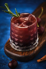 Cherry cocktail with rosemary and cinnamon.