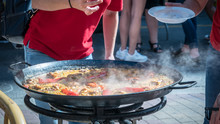Cooking A Delicious Paella Out...