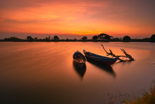 Sunset On Lake With Boat In Long Exposure  Photography Mode