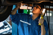 Portrait Of Asian Male Car Mechanic Performing Car Checking And Maintenace Service At Garage And Car Maintenance Service Station